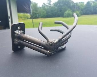 Metal pistol grip hand. Wall mount