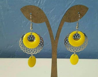yellow and silver dangling earrings