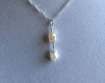 "White cultured pearls on an 18"" sterling silver chain.  Minimalist necklace."