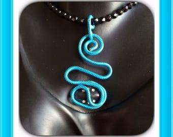 Turquoise aluminum pendant necklace.