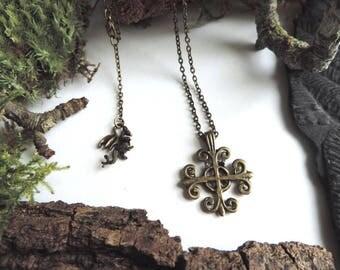 Bronze necklace: Occitan cross, bronze dragon.