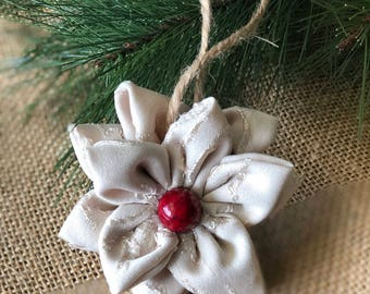 """A Little Bit of Red """"white poinsettia with red accent"""