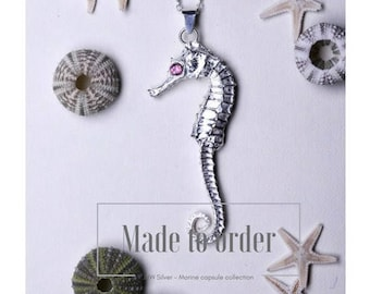 Small Sterling silver seahorse with pink tourmaline eyes