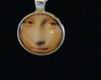 Mona Lisa pendant under glass