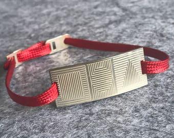 Geometric engraved silver bracelet