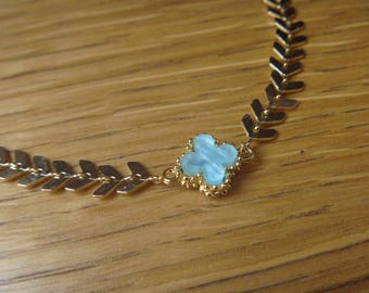 blue flower and gold link necklace
