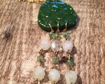 Green ceramic pendant with beaded tassel necklace
