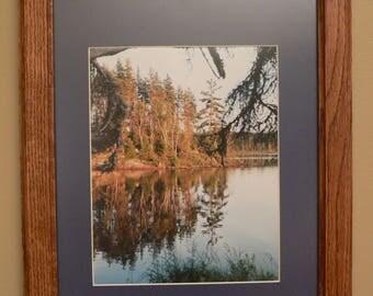 Oak Framed Photo of Reflections in Water taken in Minnesota Boundary Waters