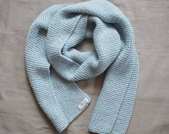 light blue knitted scarf