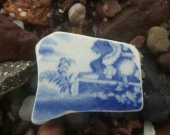 sea worn pottery with cat on frount smooth all over genuine surf tumbled vintage pottery beach find