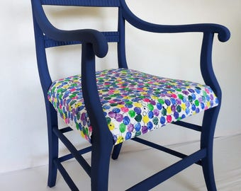Inky blue, chalk painted side chair with hand printed fabric upholstery.