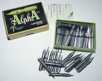 Box vintage ALPHA nibs for calligraphy or sketching. Original box with 144 nibs unused. Swiss made.