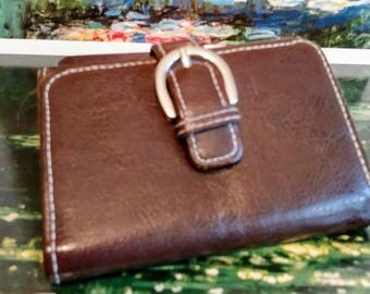 Small brown wallet with buckle decoration, snap closure