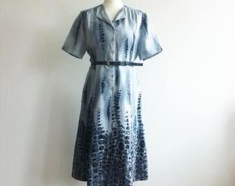 Light Blue short sleeve summer dress with abstract motif print