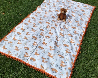 Fox  blanket with orange pom pom floor or outdoor blanket for beach picnic or play.