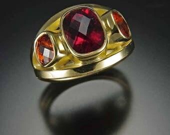 One of a kind hand fabricated ring. 18K gold, Nigerian Tourmaline, Spessartine Garnets.