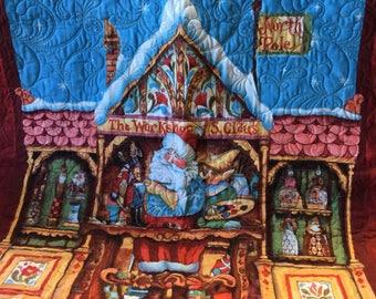 Handmade quilted Santa's workshop baby blanket!