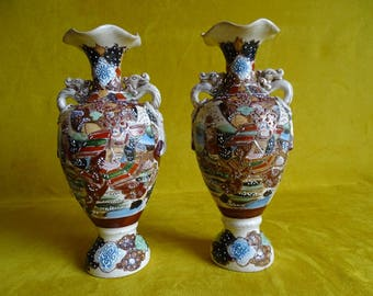 Pair of Satsuma vases with warriors and underside characters