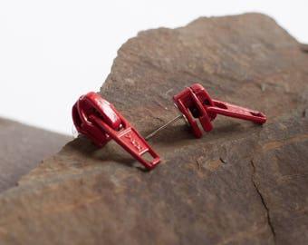 Earrings made of zippers sliders