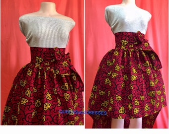 High low ankara skirt with pockets and a front sash. Red African  ankara  skirt, women's  wear. Ankara fashion