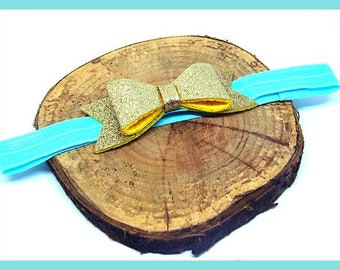 Hairband headband elastic blue color, with applique in gilded felt in the form of knot