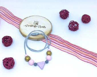 Triangle bead silicone bead necklace with painted wood beads