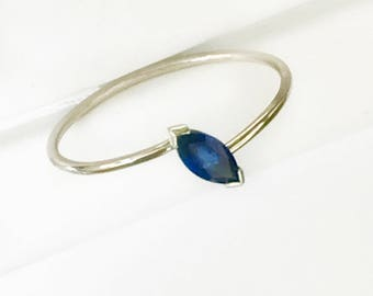 Blue sapphire marquise -shape solitaire ring