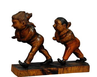 a whimsy antique woodcarving of Plisch and Plum by Wilhelm Busch