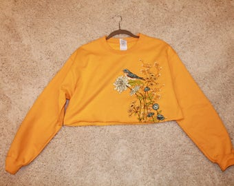 Orange Cropped Sweatshirt with flowers and blue bird