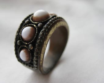 thick brass ring with white stones