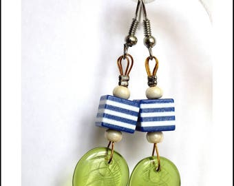 Earrings blue cubes and green leaves.