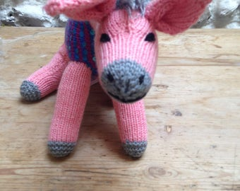 pink donkey handknit soft toy with sequins knitted in