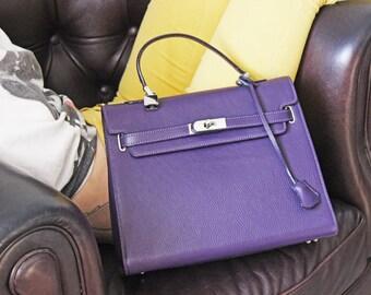 Purple leather handbag