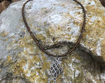 Silver Tone Pendant with Bronze Dangles on a Bronze Seedbead Necklace
