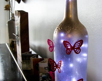 Red Butterfly Up-cycling bottle light.