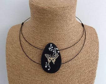 Black polymer pendant necklace and the butterfly gold