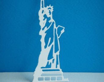 Cut the Statue of liberty in creating white drawing paper