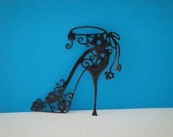 Cut shoe heel with small flowers to create black vinyl