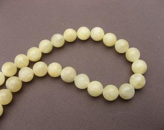 Aragonite: 5 round yellow beads 10 mm