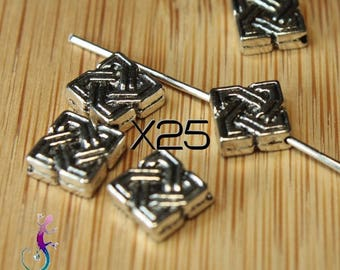 25 spacer beads with ethnic pattern in silver