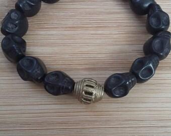 Bracelet skulls, black, brass