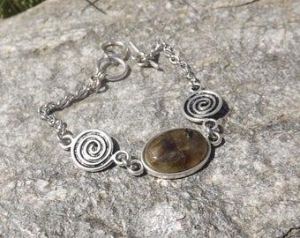 """silver metal """"spirales"""" bracelet and a labradorite cabochon"""