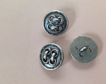 Set of three vintage, round, metal buttons