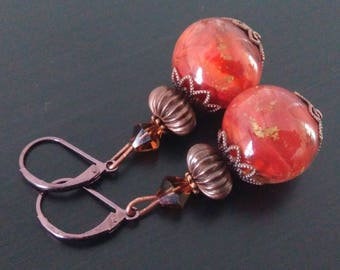 Copper earrings in red and gold.