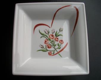 empty pockets handpainted on porcelain