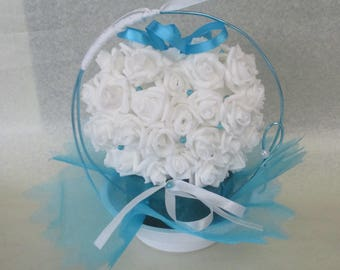 Turquoise and white wedding centrepiece