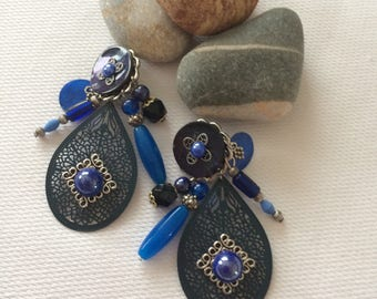 earring clips with black print and blue glass beads.