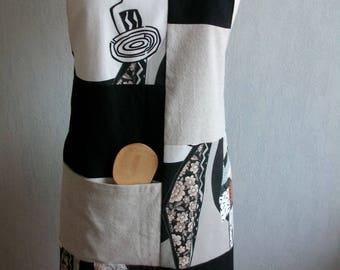 Black linen, ecru and stylized motifs African apron
