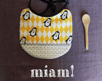 yellow, grey and black Penguin bib