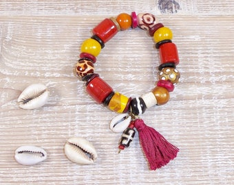 Ethnic bracelet in African glass beads, polymer clay, bone, shell cowrie, multicolor